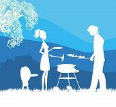 Família feliz com churrasco ao ar livre