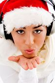 Pretty Woman Wearing Christmas Hat Giving Flying Kiss