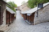 MOSTAR, BOSNIA - AUGUST 10, 2012: Pebble stone streets in old town on August 10, 2012 in Mostar, Bos
