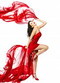 Woman  In Red Dress Dancing With Fabric Flying On A Wind Flow