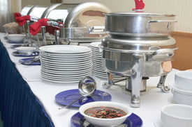 stock photo of chafing  - Plates cutleries and chafing dish in buffet catering industry - JPG