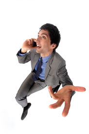 pic of pep talk  - Peppy businessman talking on his mobile phone - JPG