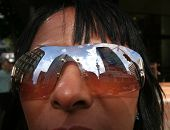 Sky Tower Reflection In Sunglasses poster