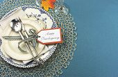 image of doilies  - Beautiful vintage Thanksgiving dinner table place setting with vintage shabby chic blue plate and antique silverware on lace doily and aqua blue tablecloth with copy space - JPG