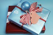 image of christmas theme  - Modern trend for Christmas decor color theme of aqua blue and red gift wrapped presents with festive berry and bauble decorations - JPG