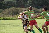 Rugby Player Stopping An Opponent