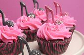 stock photo of cake stand  - Female high heel shoes decorated pink and black red velvet cupcakes with high heel shoes for teenage female birthday or wedding bridal shower  - JPG