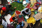 People buy and sell spice at open air market