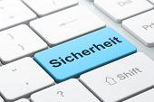 Privacy concept: Sicherheit(german) on computer keyboard backgro
