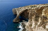 image of grotto  - Nice Blue Grotto view in Malta island with two boat in the clear blue sea - JPG