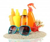 Bottles with suntan cream and sunglasses, isolated on white