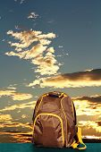 Backpack On The Background Of Sky.
