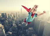 stock photo of skyscrapers  - A little superhero ready to save the world - JPG