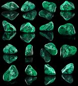 Collection set of malachite mineral stone close up  with reflection on black surface background