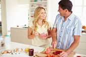 Couple Preparing Healthy Breakfast In Kitchen