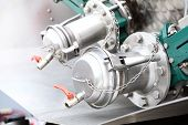 stock photo of vacuum pump  - Industrial details of new sewage truck equipment valves - JPG