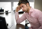 Tired Or Frustrated Office Worker Looking At Computer Screen