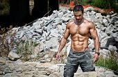 stock photo of shirtless  - Muscle man shirtless outdoors in building site - JPG