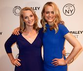 NEW YORK-OCT 2: Actress Taylor Schilling (R) & writer Piper Kerman attend 'Orange Is the New Black'