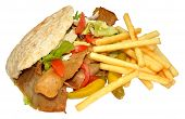 stock photo of pita  - A takeaway doner kebab in a pita bread with fries - JPG
