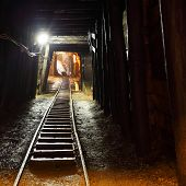 stock photo of underpass  - Historical gold silver copper mine with machine - JPG