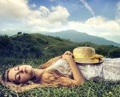 beautiful woman sleeping on the grass