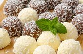 detail of chocolate pralines breaded in grated coconut