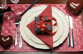 Formal Valentine Dinner Table Setting For One With Champagne Glasses And Black Box Present Gift On M