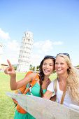 Travel tourists friends holding map in Pisa, Italy looking and pointing. Women girlfriends traveling