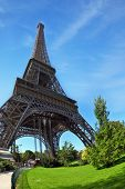 Touring Paris. Park at the foot of the Eiffel Tower. Unexpected angle fisheye lens takes