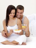 Couple Having Nutritive Breakfast Sitting In Bed