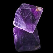 Purple Violet Fluorite with reflection on black surface background