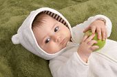 beautiful baby girl with green apple