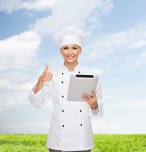 cooking, technology and food concept - smiling female chef, cook or baker with tablet pc computer sh