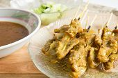 Grilled Pork Served With Peanut Sauce