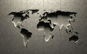 3D World Map molded into solid concrete blocked wall (Elements in this image derived from NASA earth