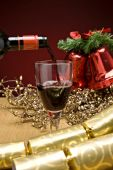 stock photo of christmas party  - Red wine being poured in a christmas decorated table - JPG