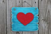 Antique blue sign with large red heart