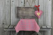 Blank sign with red heart by picnic table