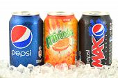 Can of Pepsi, Mirinda and Pepsi Max drink on ice