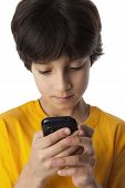 Eight year old boy reading text message on white background