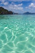 Crystal-clear blue water at El Nido in Palawan Province in the Philippines, a protected area of grea