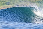 perfect surfing wave in Indonesia.