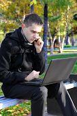 Sad Man With Laptop Outdoor