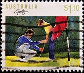 AUSTRALIA - CIRCA 1990: a stamp printed in Australia shows young boy being taught golf circa 1990