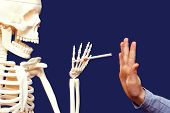stock photo of taboo  - Death offers man a cigarette - JPG