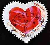 FRANCE - CIRCA 2003: A stamp printed in France showing a seal with the petals of a pink heart-shaped