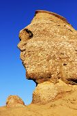 View of Sfinx, a natural mountain formation in the form of a human face meditating in Busteni, Roman