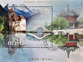 SWITZERLAND - CIRCA 1998: stamp printed in Switzerland shows a landscape with a castle and a pagoda