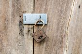 Unlocked Key On Old Wooden Door